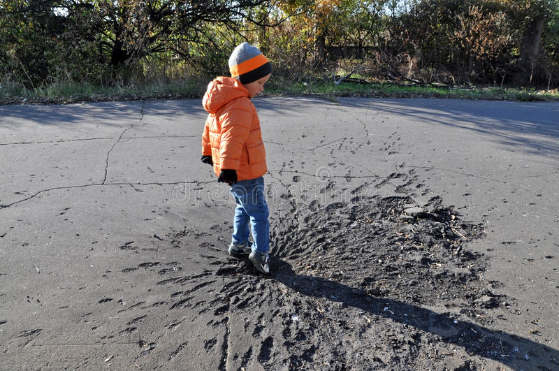 Boy exploring shell crater. Ukraine royalty free stock images