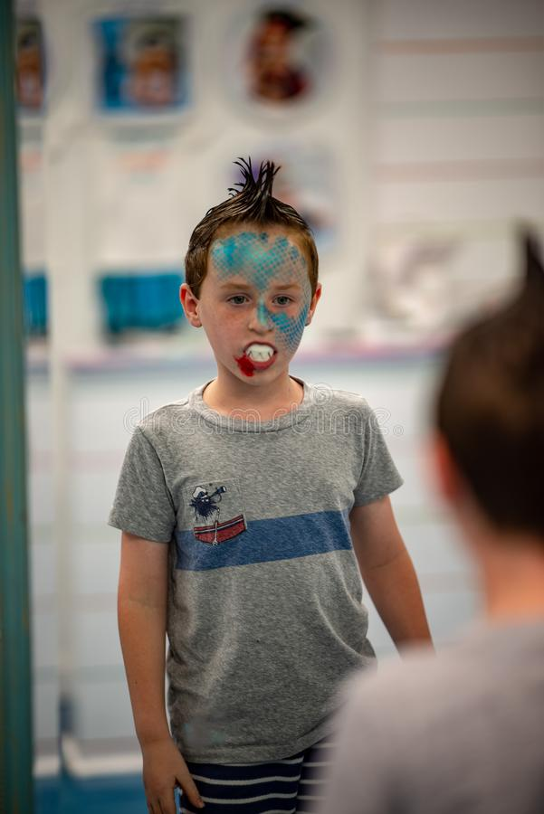 Boy with face painted like a shark royalty free stock photography