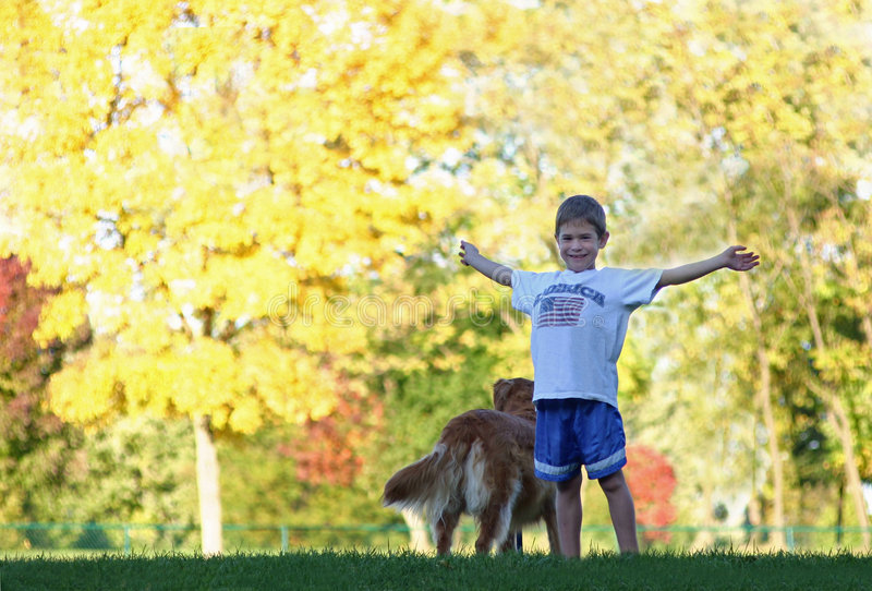 Boy in the Fall. Boy enjoying a beautiful fall day with dog stock images
