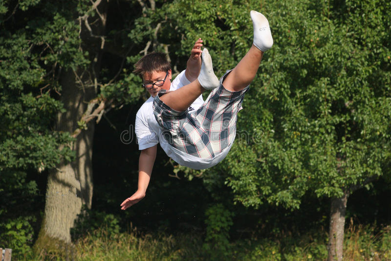 Boy falling down royalty free stock image