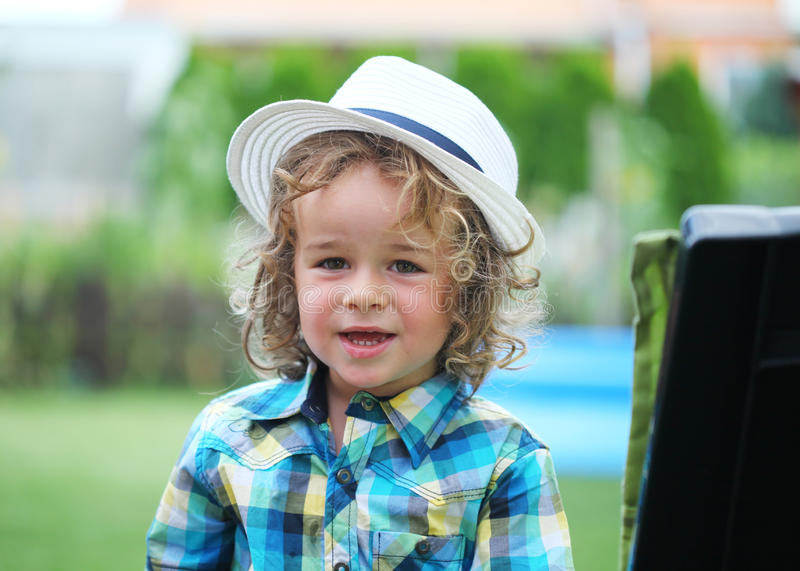 Boy with fashion hat in nature stock image