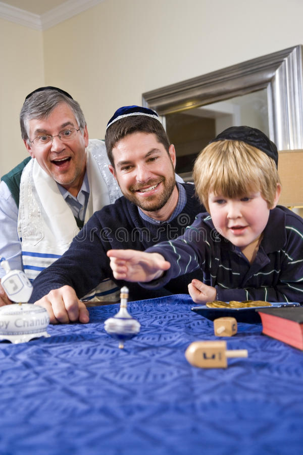 Download Boy With Father And Grandfather Spinning Dreidel Stock Image - Image of generational, dreidl: 15150925