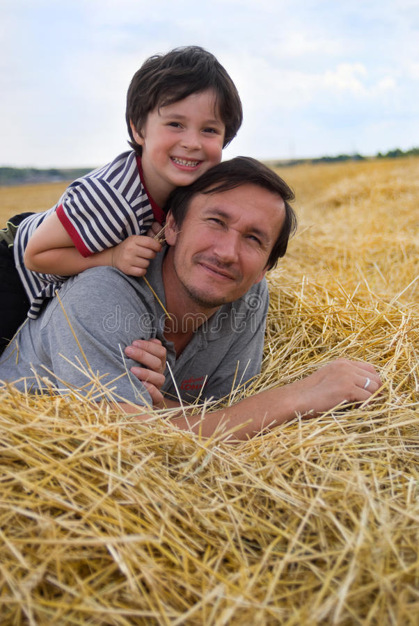 Download The boy and father on hay stock image. Image of carefree - 11027607