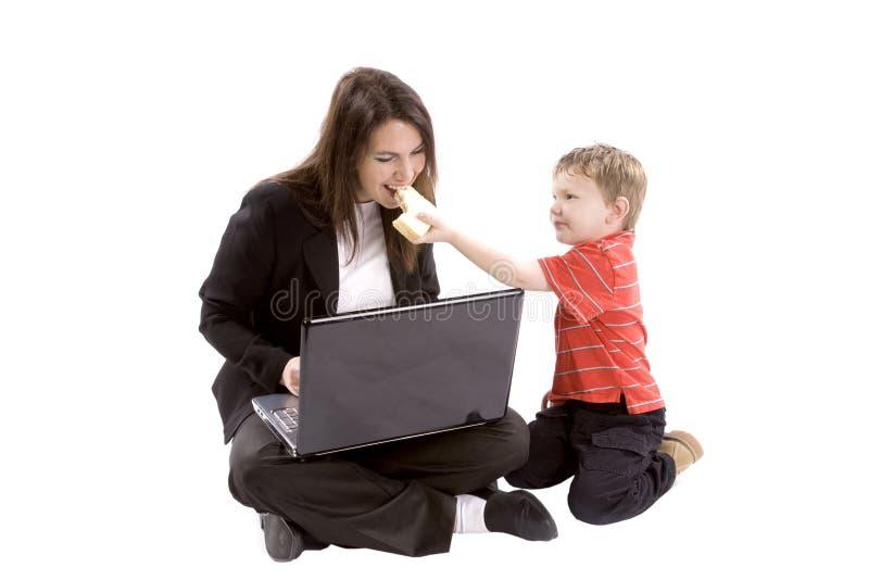 Boy Feeding Mom Royalty Free Stock Image