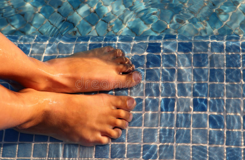 Download Boy Feet Are Jointed And Putted In Water Stock Image - Image: 17887335