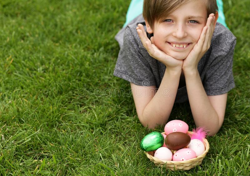 Boy with festive easter eggs stock image