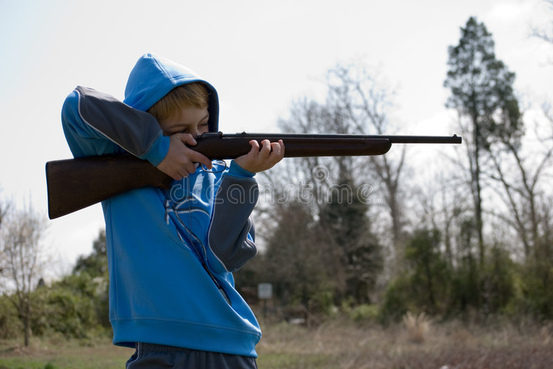 Download Boy firing rifle stock image. Image of hunt, weapon, sporting - 4644461