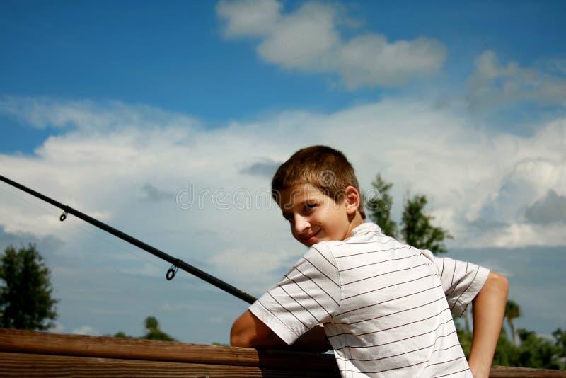 Boy fishing stock photos
