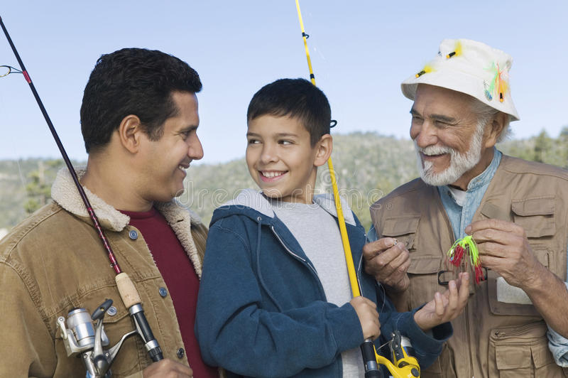 Download Boy Fishing With Father And Grandfather Stock Photo - Image: 29645546