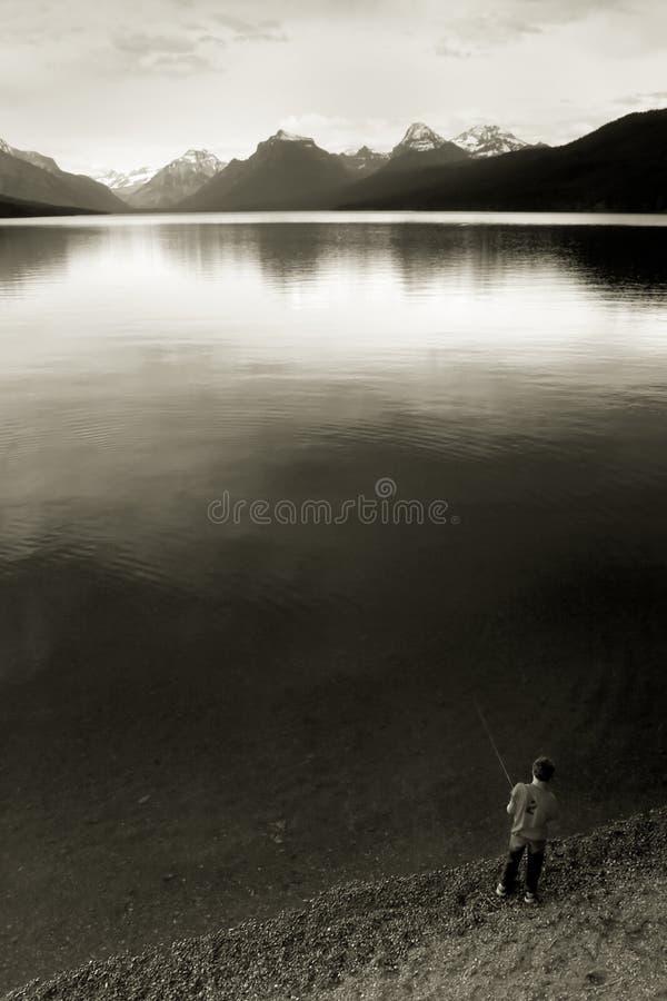 Free Boy Fishing, Lake McDonald Royalty Free Stock Photos - 425408