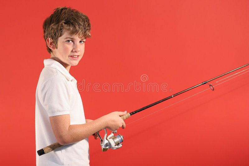 Boy with fishing pole stock photo