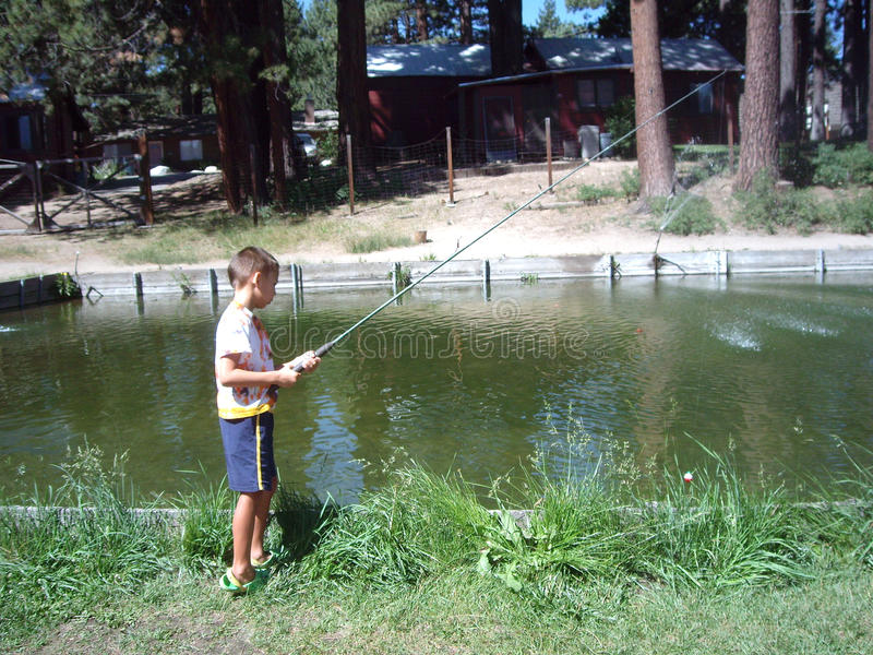 Boy Fishing at the pond stock image