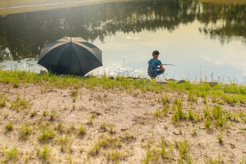 Boy fishing in the pond royalty free stock images