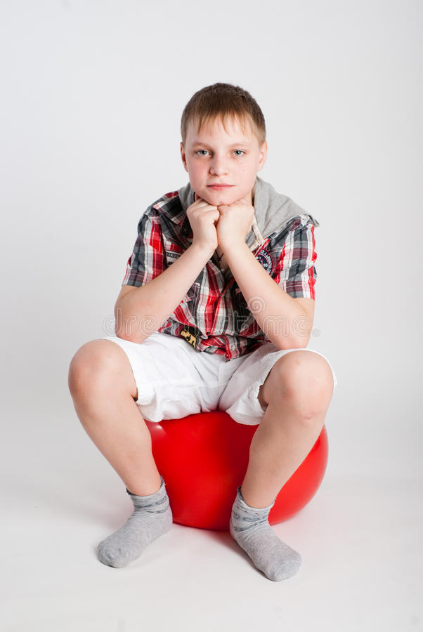Download Boy on fitball stock photo. Image of socks, shorts, shirt - 18242040