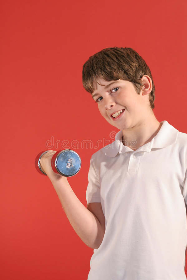 Boy with fitness weights royalty free stock images