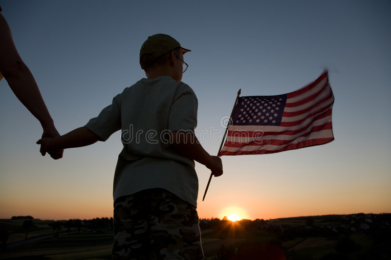 Boy and flag royalty free stock photography