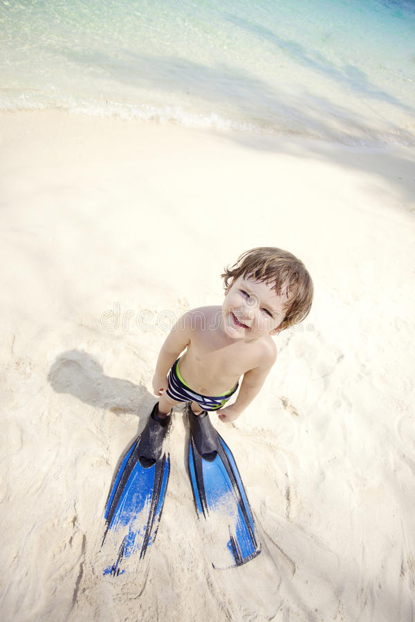 Boy in flippers stock photos