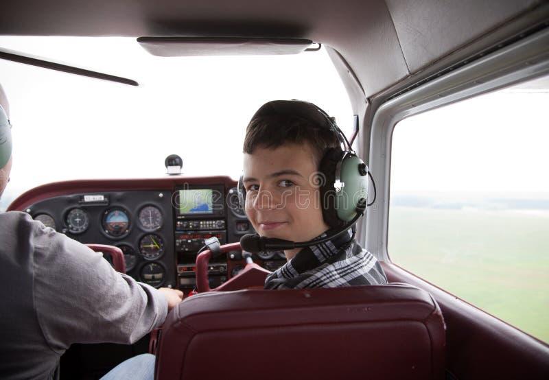 Download Boy Fliyng In The Plane Cabin Stock Image - Image: 20775379