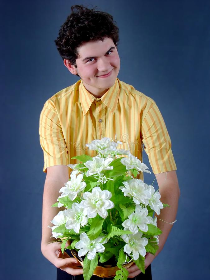 Boy with flowers royalty free stock photo
