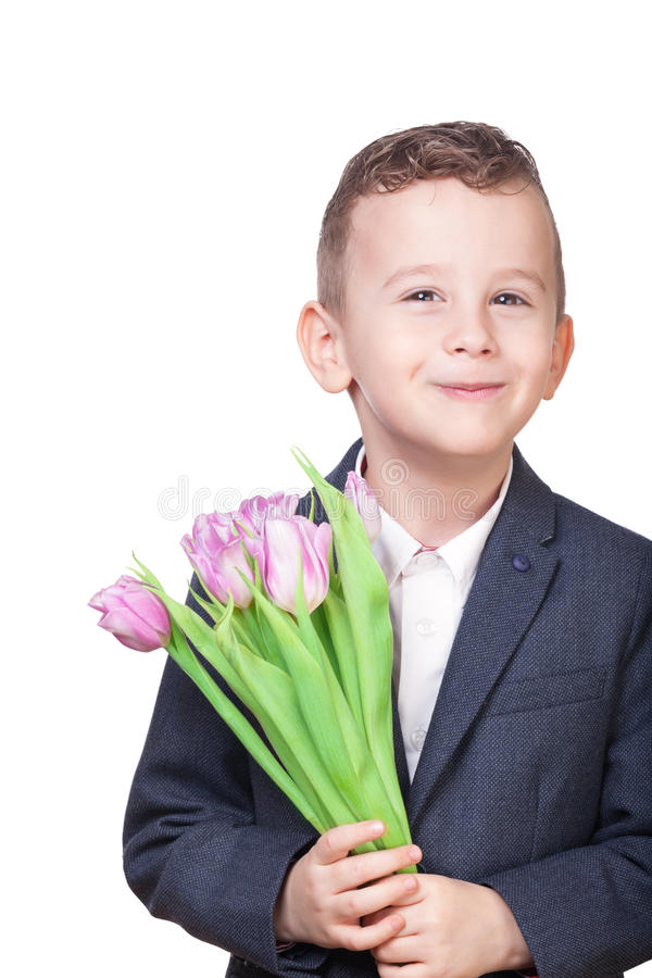 Boy with flowers. On isolated white royalty free stock photos