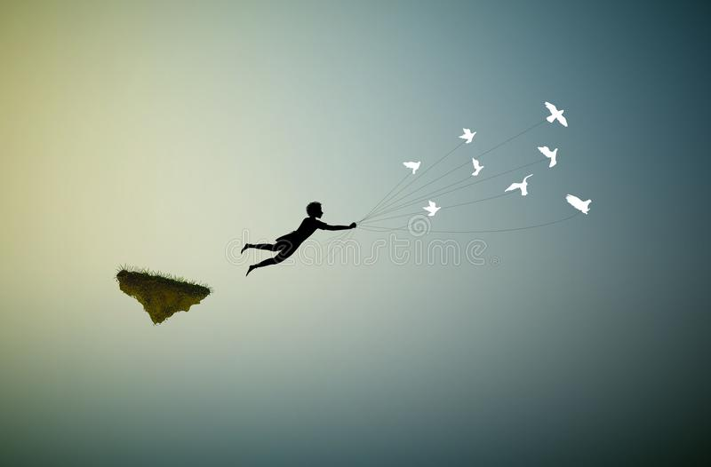 Boy is flying away and holding pigeons, fly in the dream land,fly away, shadows,. Life on flying rock, silhouette royalty free illustration