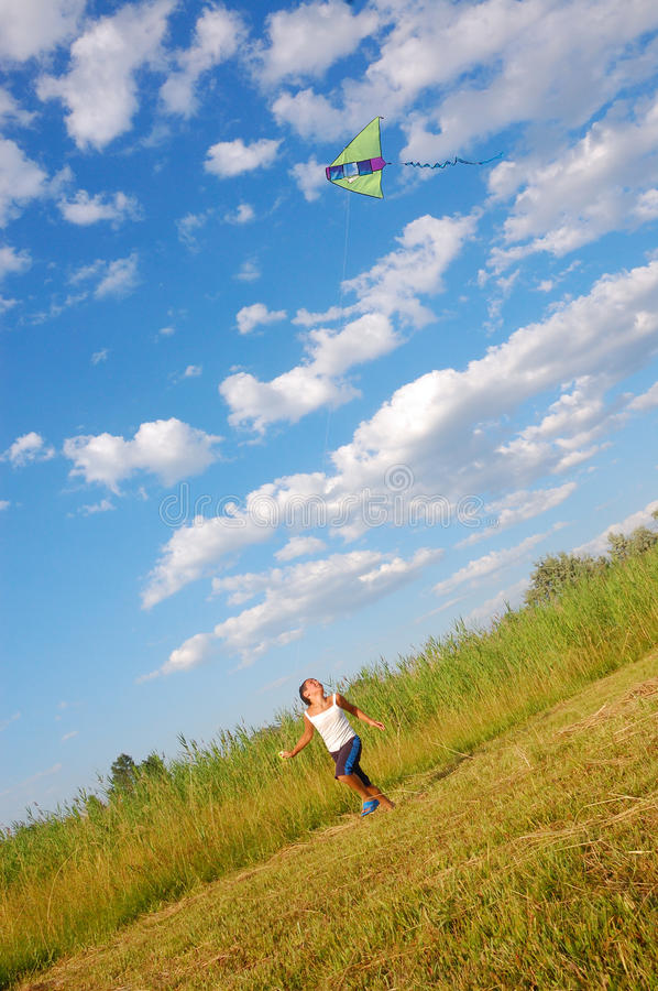 Boy flying a kite royalty free stock images