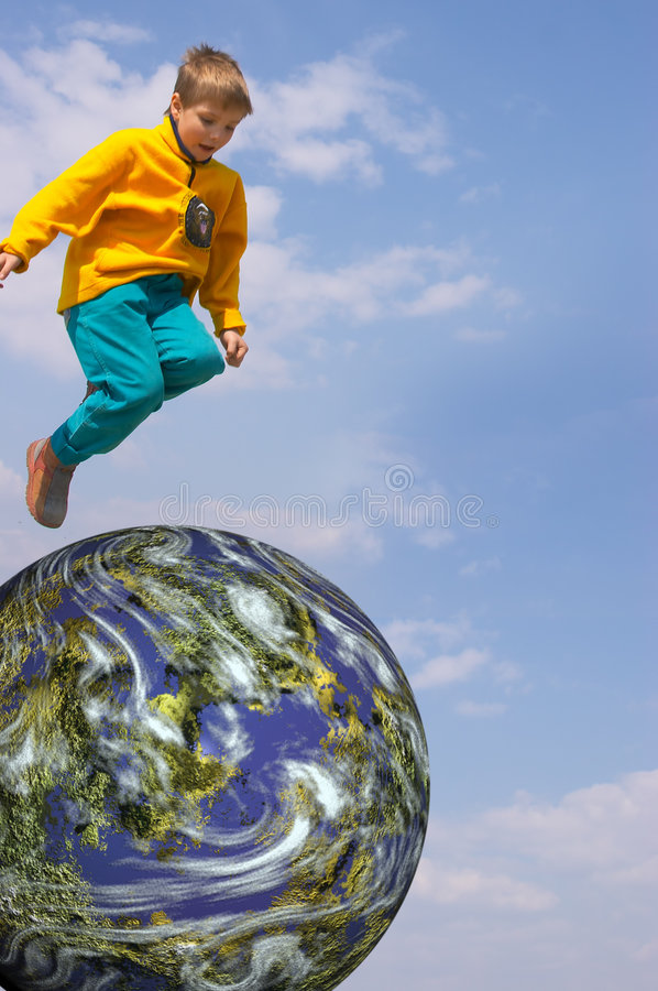 Boy Flying Over the Earth stock images