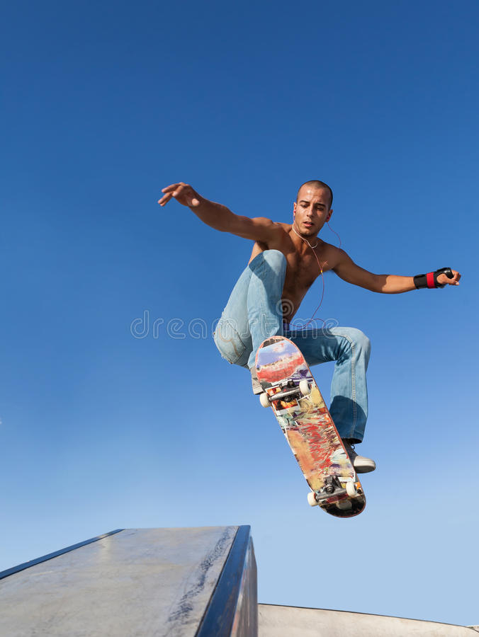 Boy flying on a skateboard. Sport background royalty free stock images