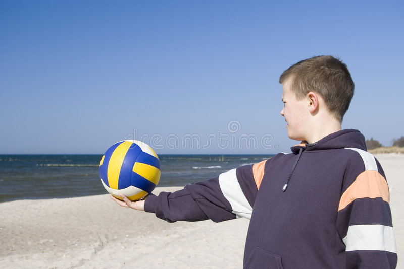 Download Boy with football on beach stock photo. Image of standing - 2242876