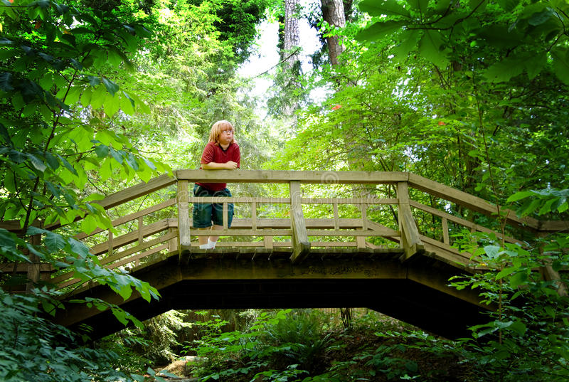 Boy On A Footbridge Royalty Free Stock Images