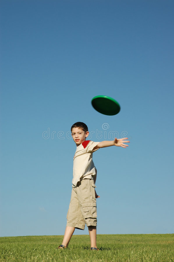 Boy with frisbee stock photo