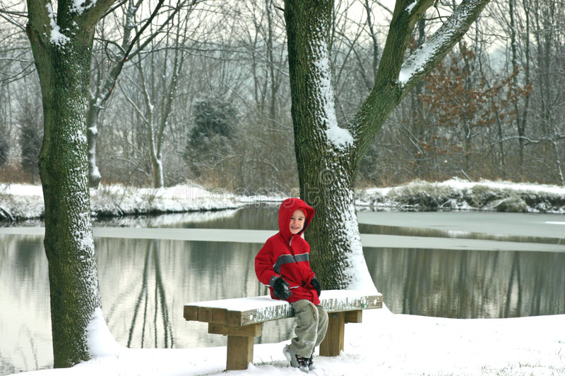 Boy In Front of Pond royalty free stock photo