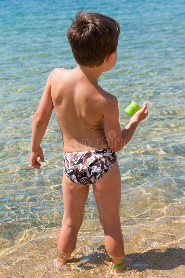 Boy in front of sea stock photography