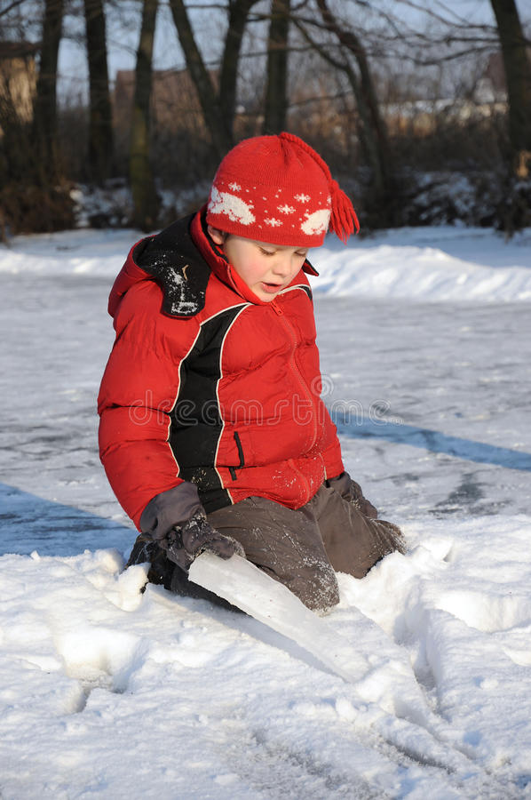 Download Boy on frozen river stock photo. Image of ring, frost - 27731098