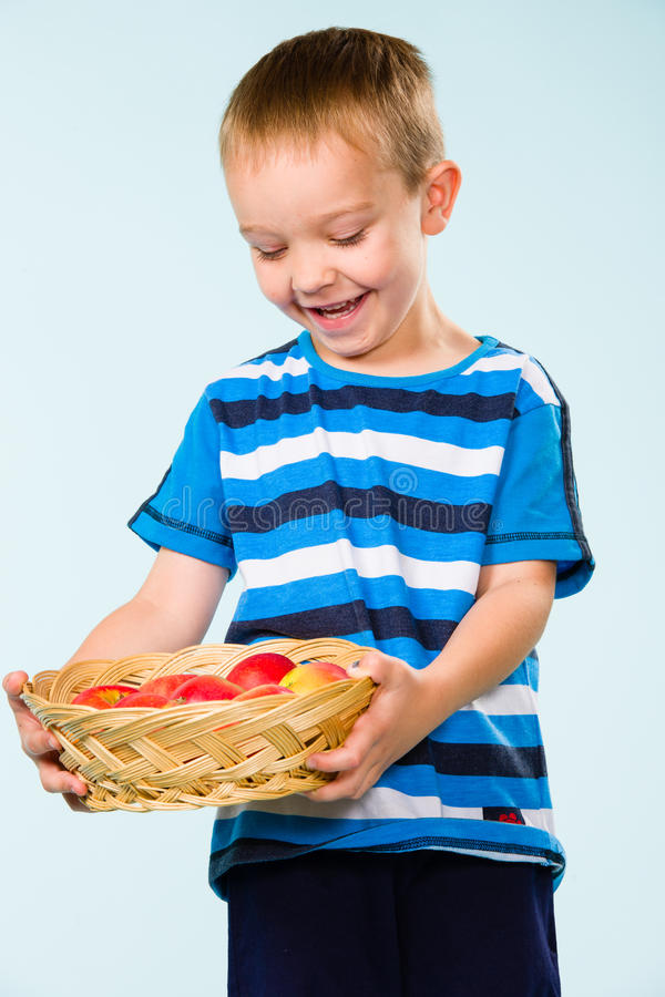 Download Boy and fruit basket stock photo. Image of candid, eatable - 33950500