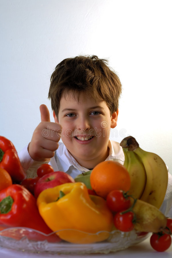 Boy and fruits stock photos