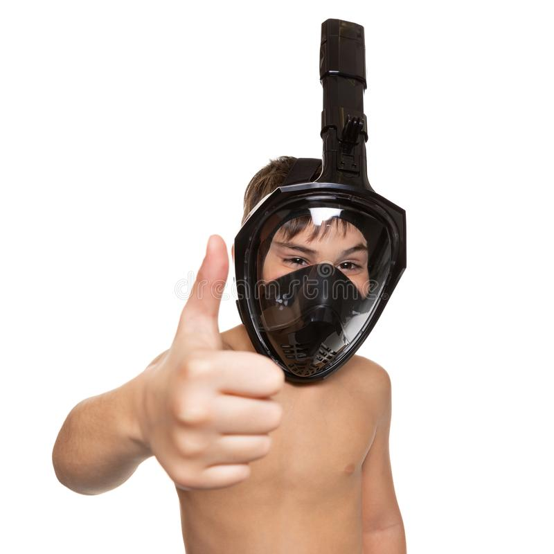 Boy in full face diving mask, one hand shows gesture ok, smiles at the camera, on white background stock photos