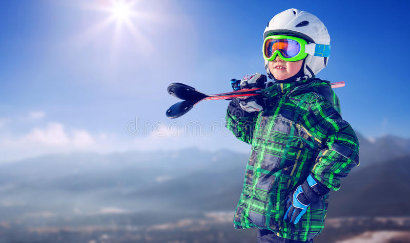 Boy in full ski equipment on the mountain view royalty free stock photo