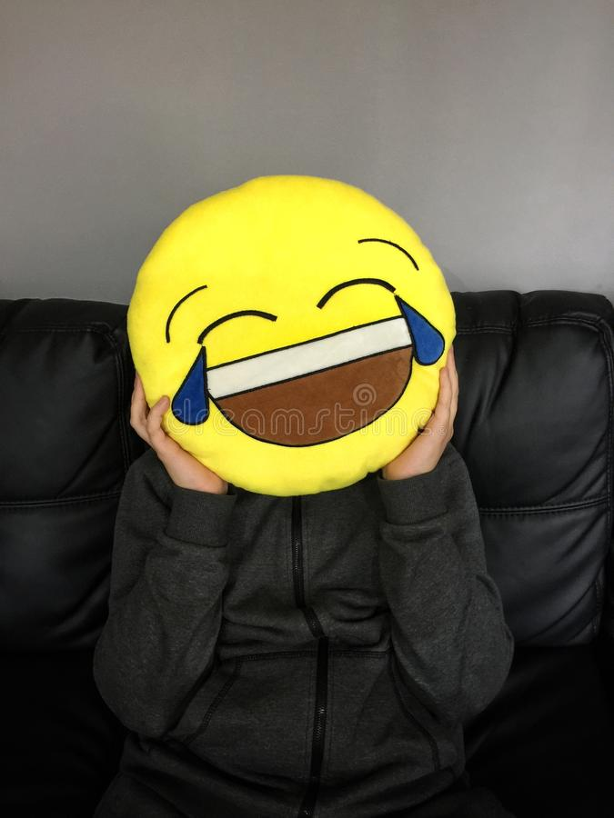 Boy with funny emoticon face. Boy making a joke with an emoticon funny face royalty free stock photo