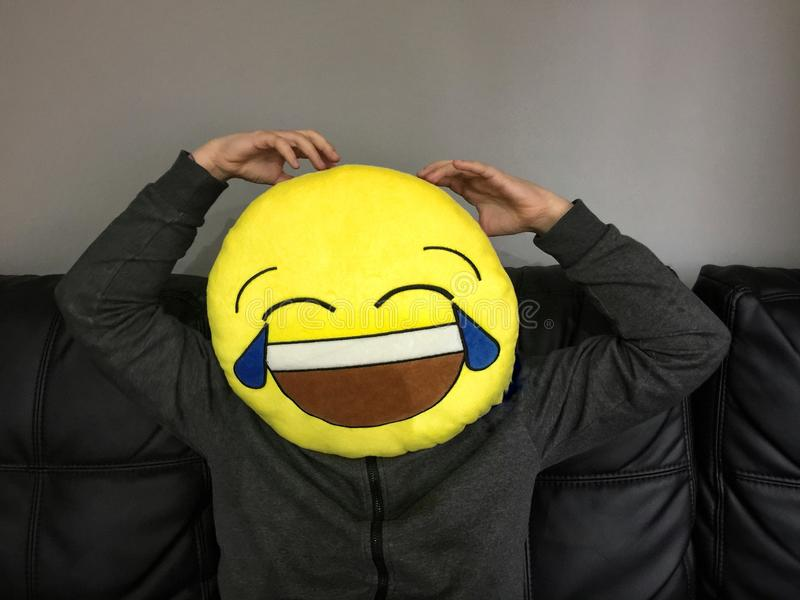 Boy with funny emoticon face. Boy making a joke with an emoticon funny face stock images