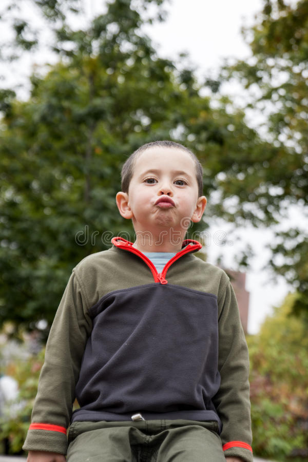 Boy funny posing stock images