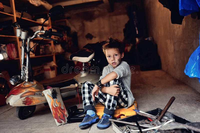 Download Boy in the garage stock photo. Image of moped, small - 33590766