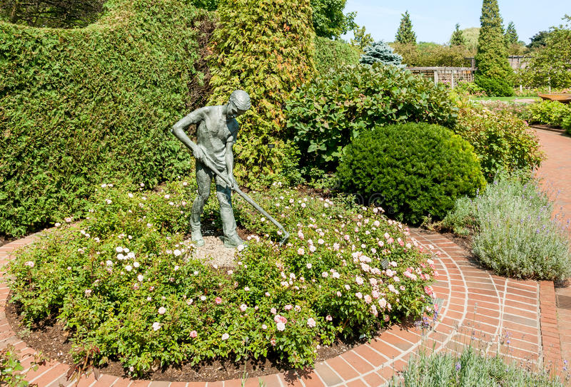 Boy Gardener bronze statue in the Chicago Botanic Garden, USA royalty free stock images