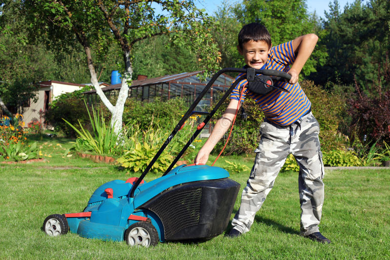 Boy Gardener Mowing The Lawn Stock Image - Image of growth, cutter ...