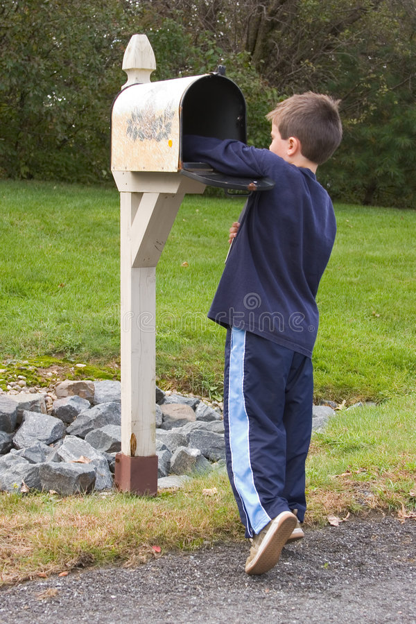 Boy getting mail royalty free stock photography
