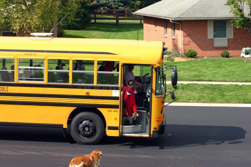 Boy Getting off School Bus stock photos