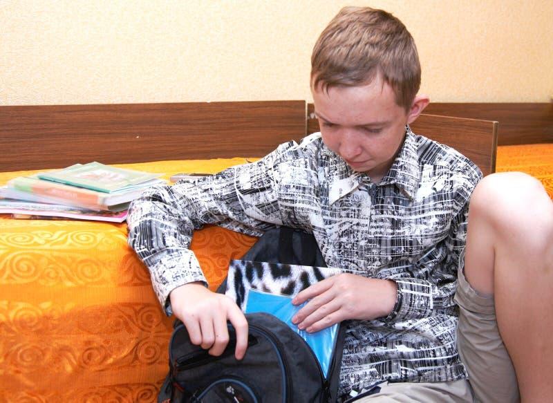 Boy getting ready for school stock photos