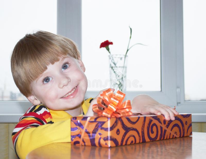 Download The boy with a gift stock photo. Image of expression - 14553534