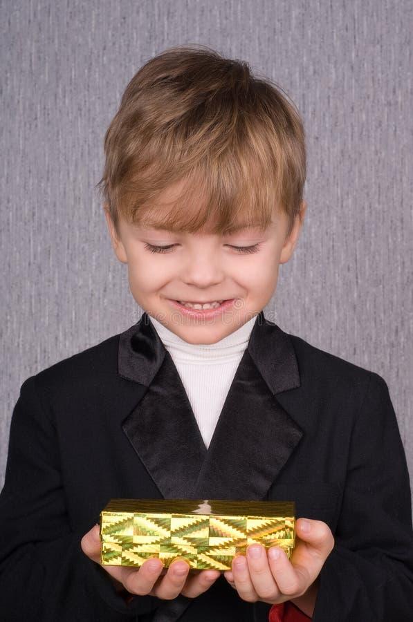 Boy and gift box stock photo