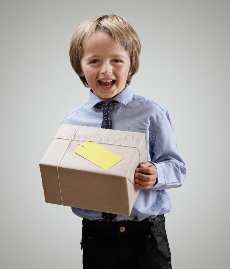 Boy with gift stock photo